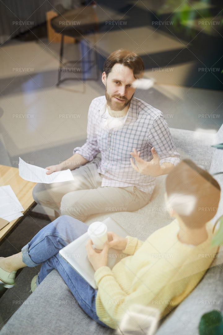 Young Marketing Specialists Talking...: Stock Photos
