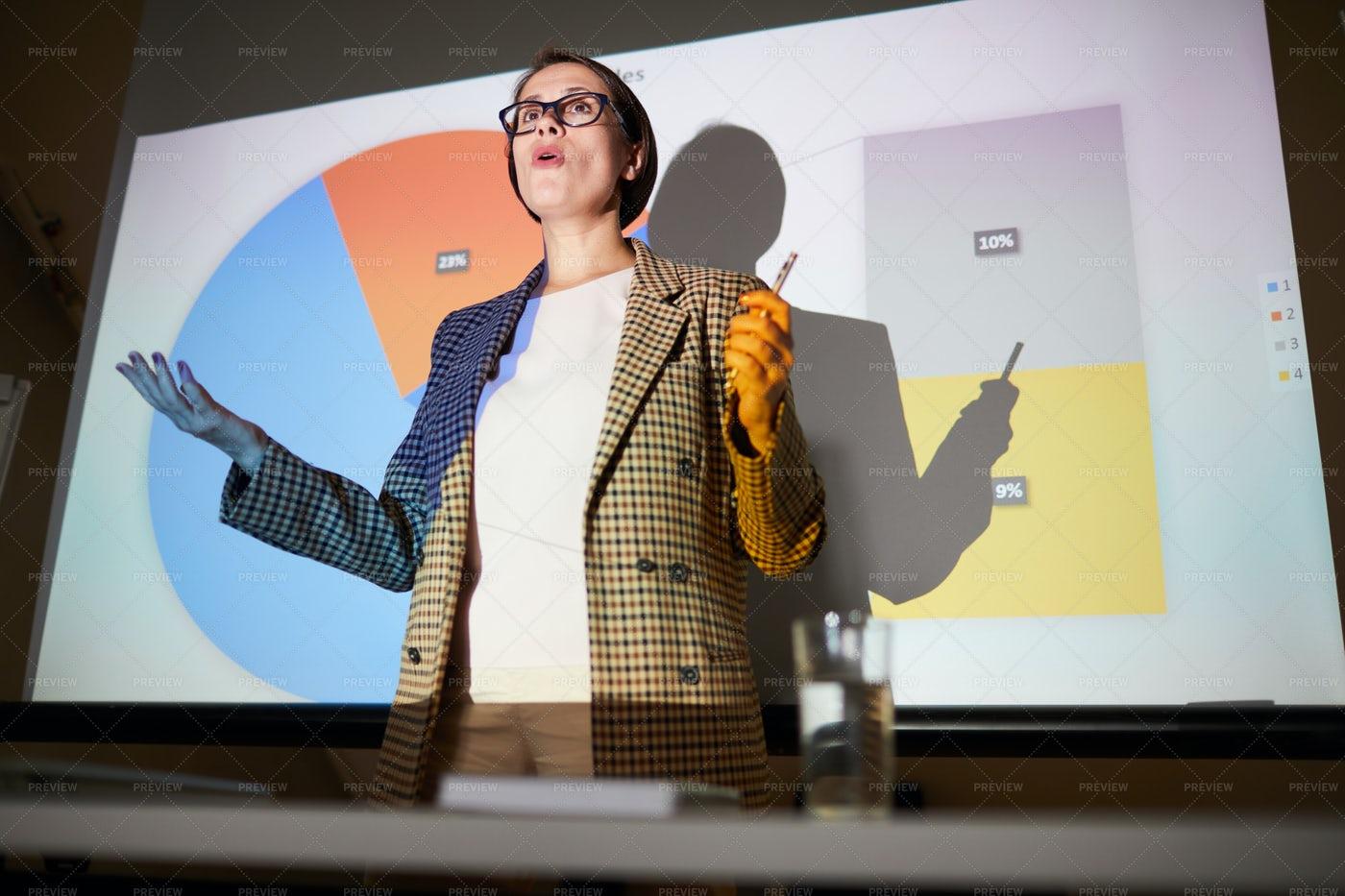 Confident Lady Explaining Data On...: Stock Photos