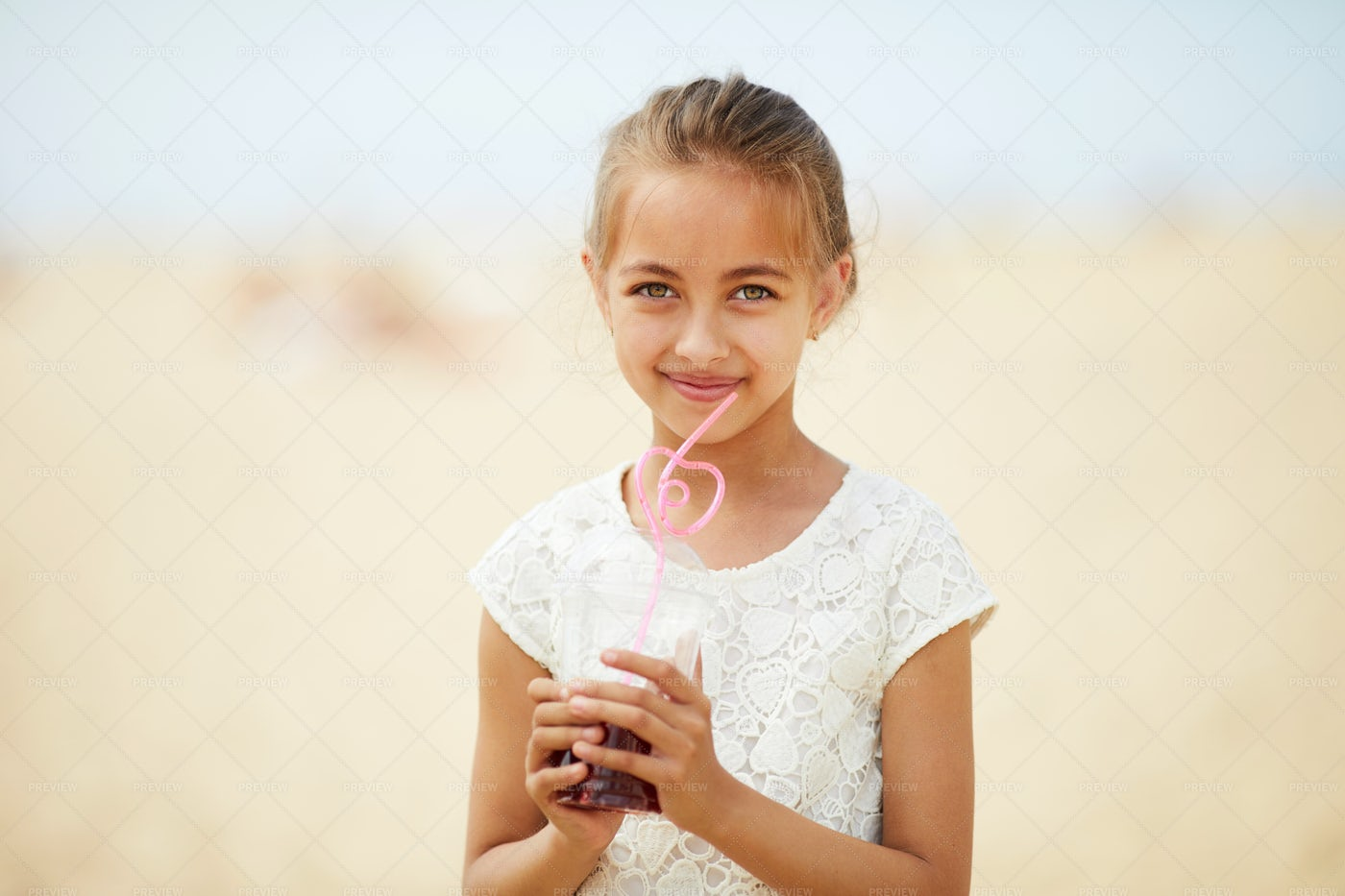 Pretty Little Girl With Cocktail: Stock Photos