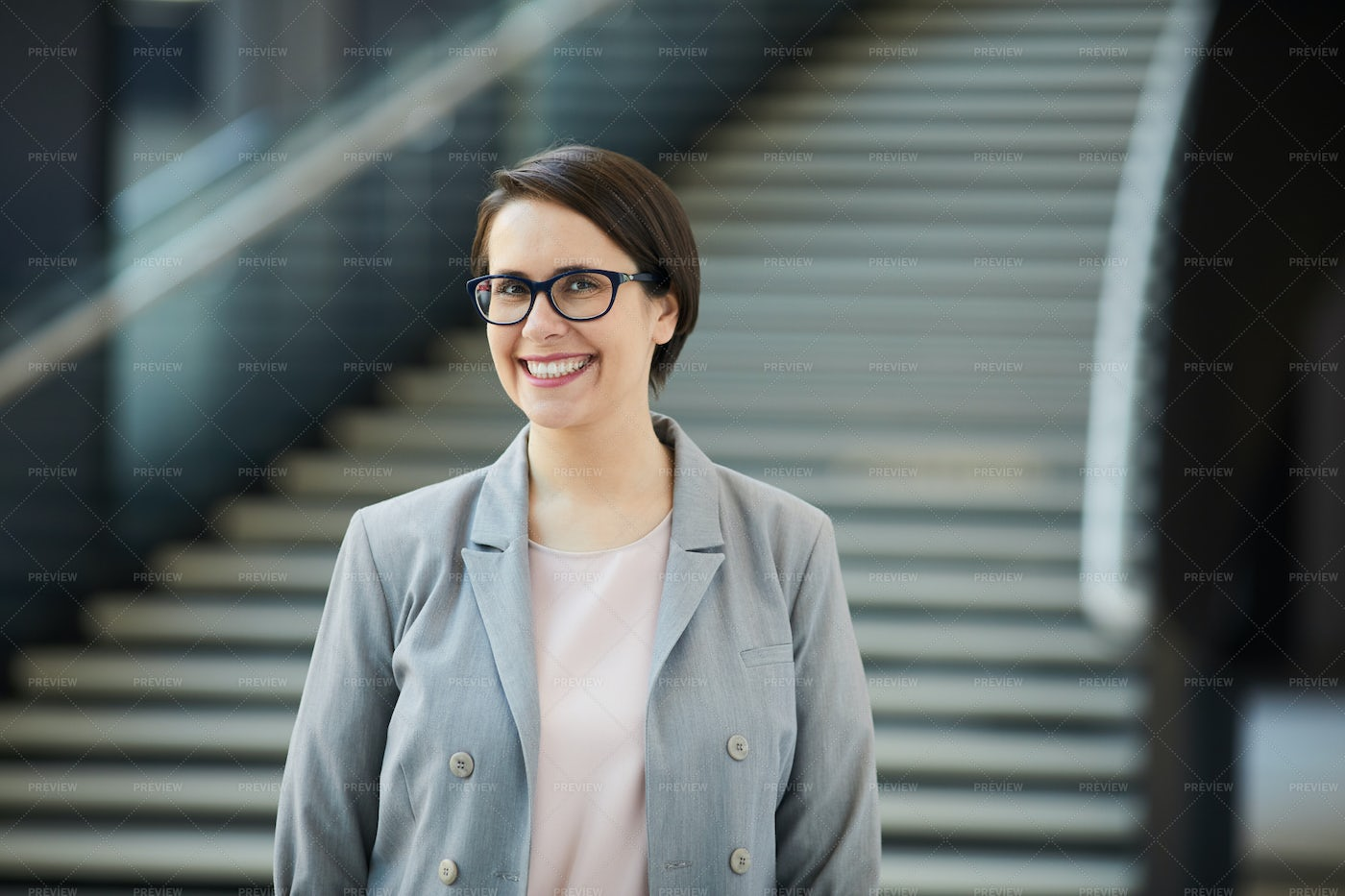 Cheerful Project Manager In Lobby: Stock Photos