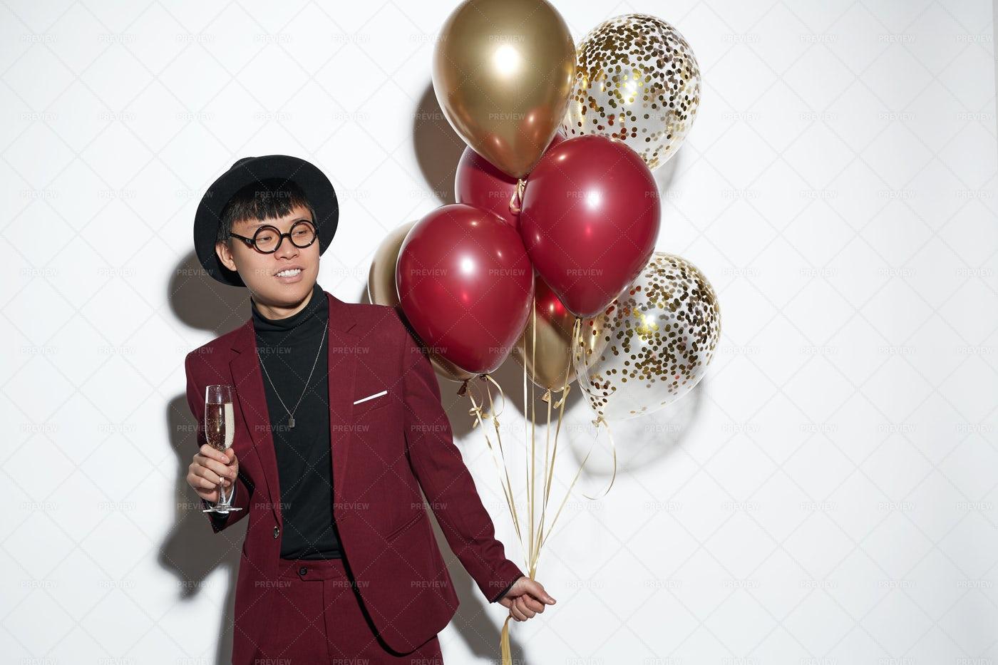 Asian Man Holding Balloons At Party: Stock Photos