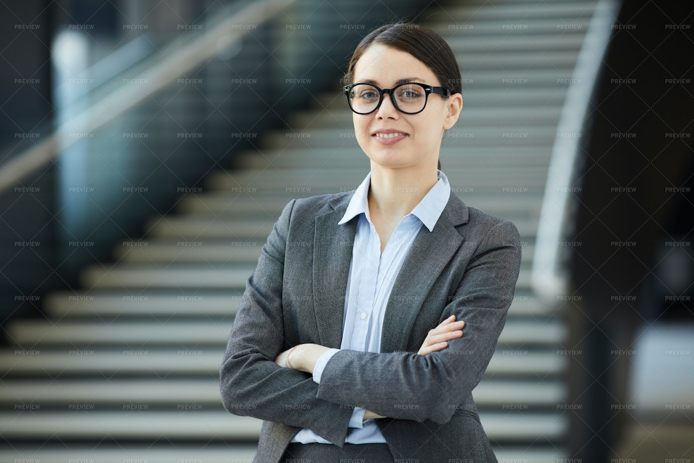 Positive Young Female Intern In...: Stock Photos