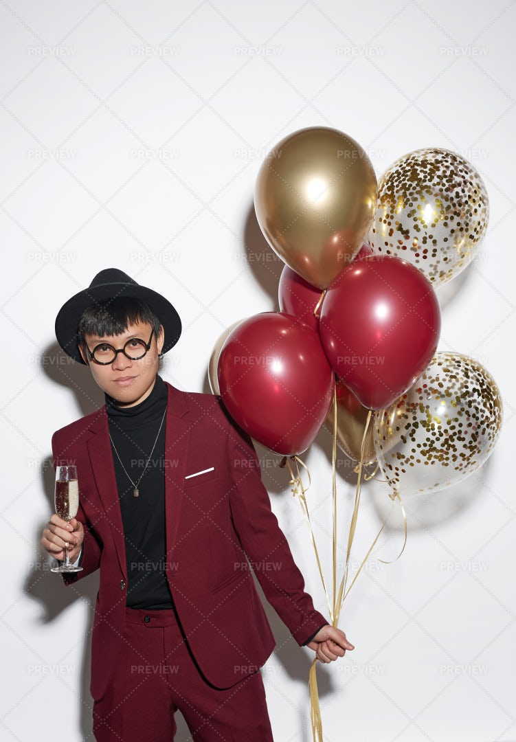 Young Asian Man Holding Balloons At...: Stock Photos