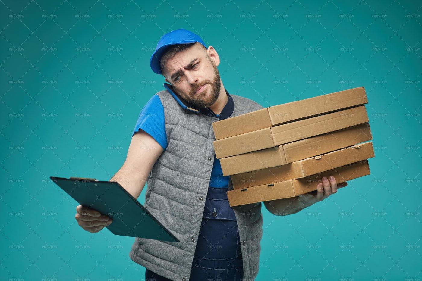 Pizza Guy Checking Order: Stock Photos