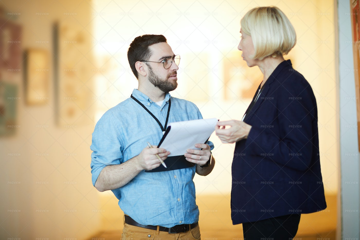 Two Art Gallery Workers: Stock Photos