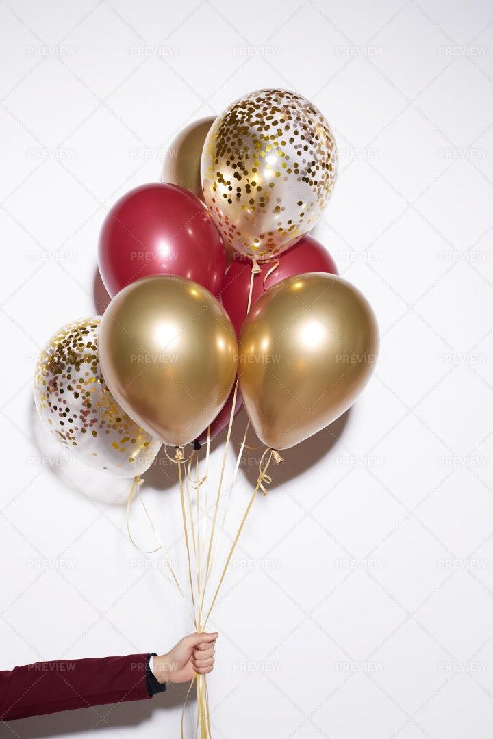 Hand Holding Balloons On White: Stock Photos