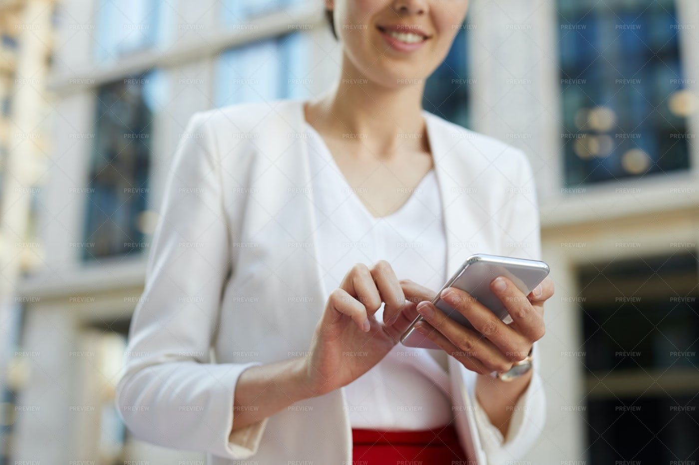 Businesswoman Using Smartphone...: Stock Photos