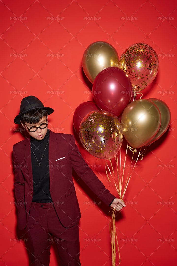 Trendy Asian Man On Red: Stock Photos