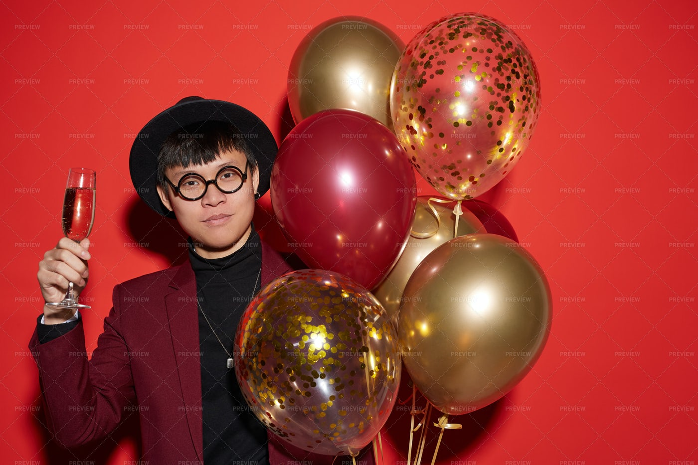 Party Shot Of Asian Man On Red: Stock Photos