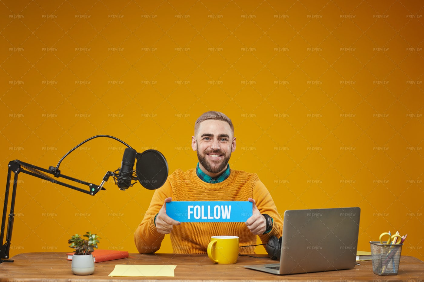 Vlogger Holding Follow Sign Plate: Stock Photos