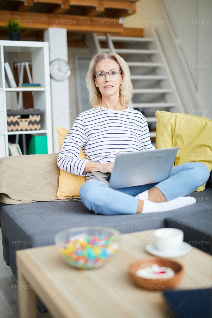 Mature Woman Writing Blog: Stock Photos
