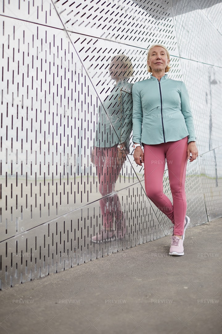 Sportswoman By Wall: Stock Photos