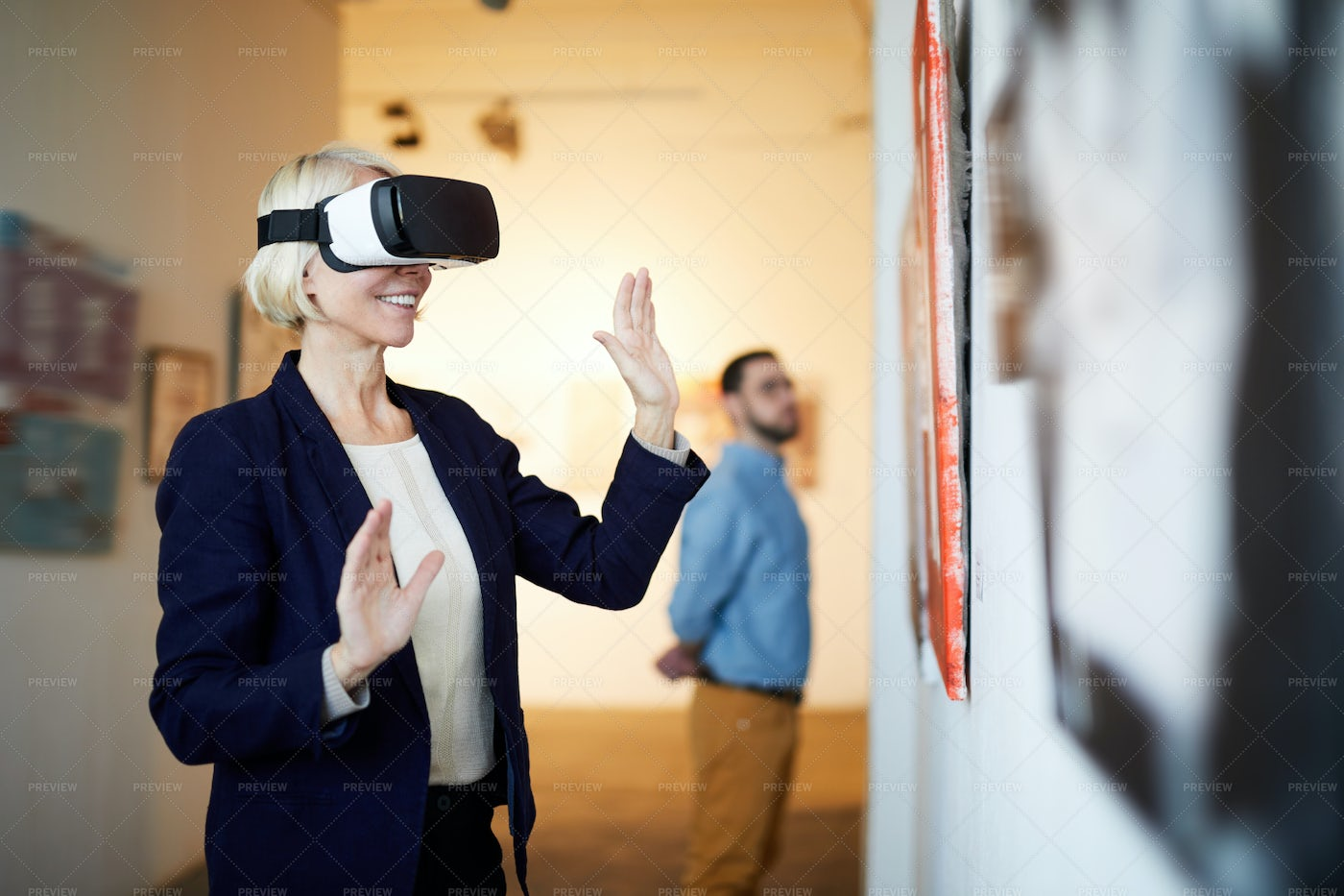 Woman In VR Museum: Stock Photos