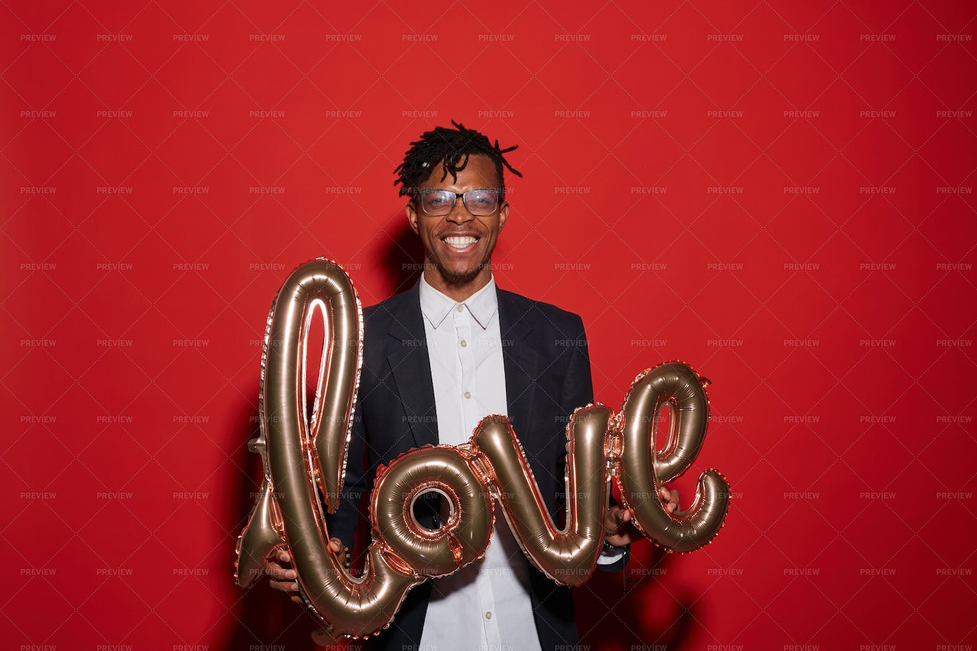 Trendy African Man Holding Love...: Stock Photos