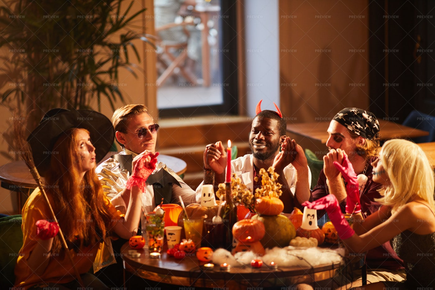 Friends Dining At Halloween Party: Stock Photos