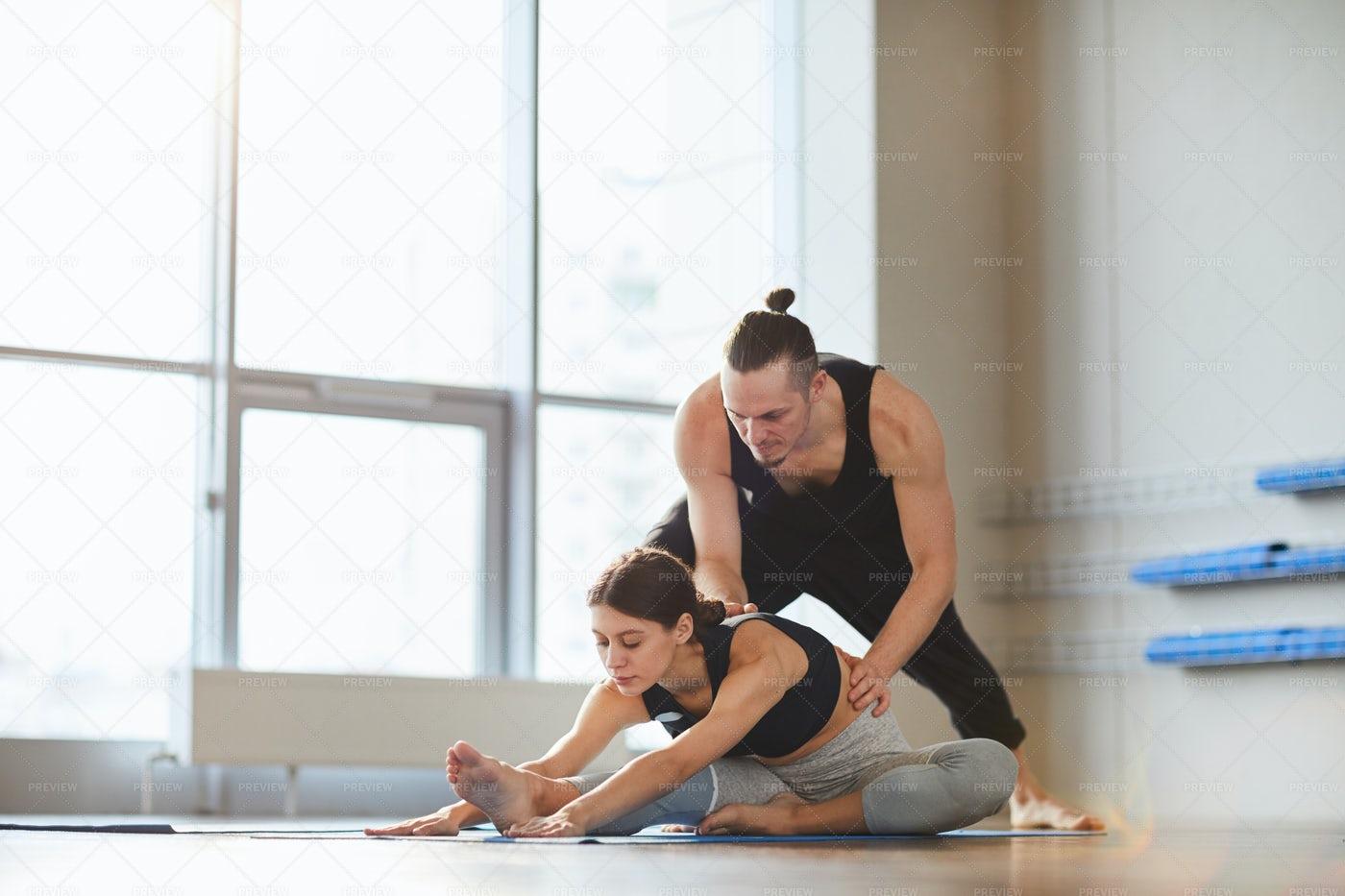 Yoga Teacher Helping Girl To Bend: Stock Photos