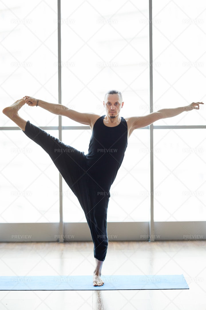 Yogis Balancing On One Leg: Stock Photos