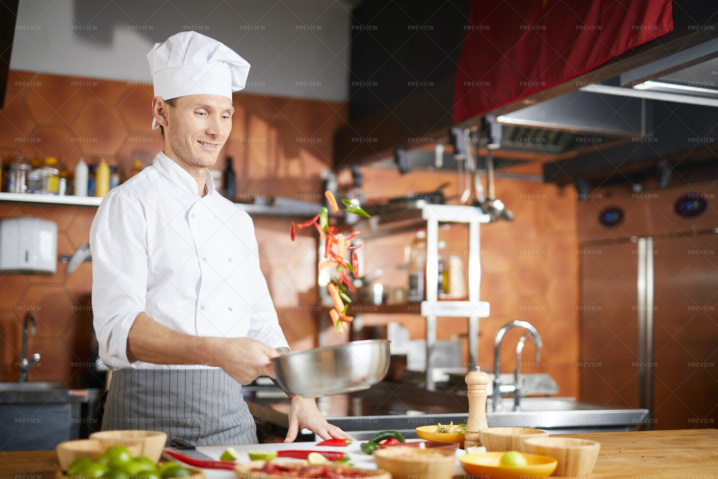 Handsome Chef Cooking Vegetables: Stock Photos