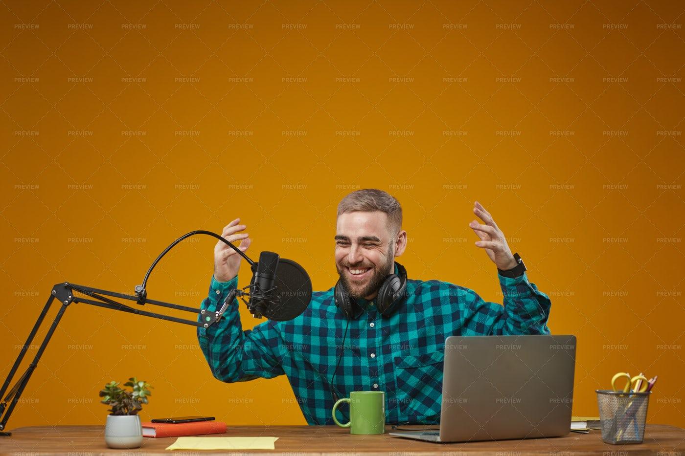 Joyful Radio Presenter Working: Stock Photos
