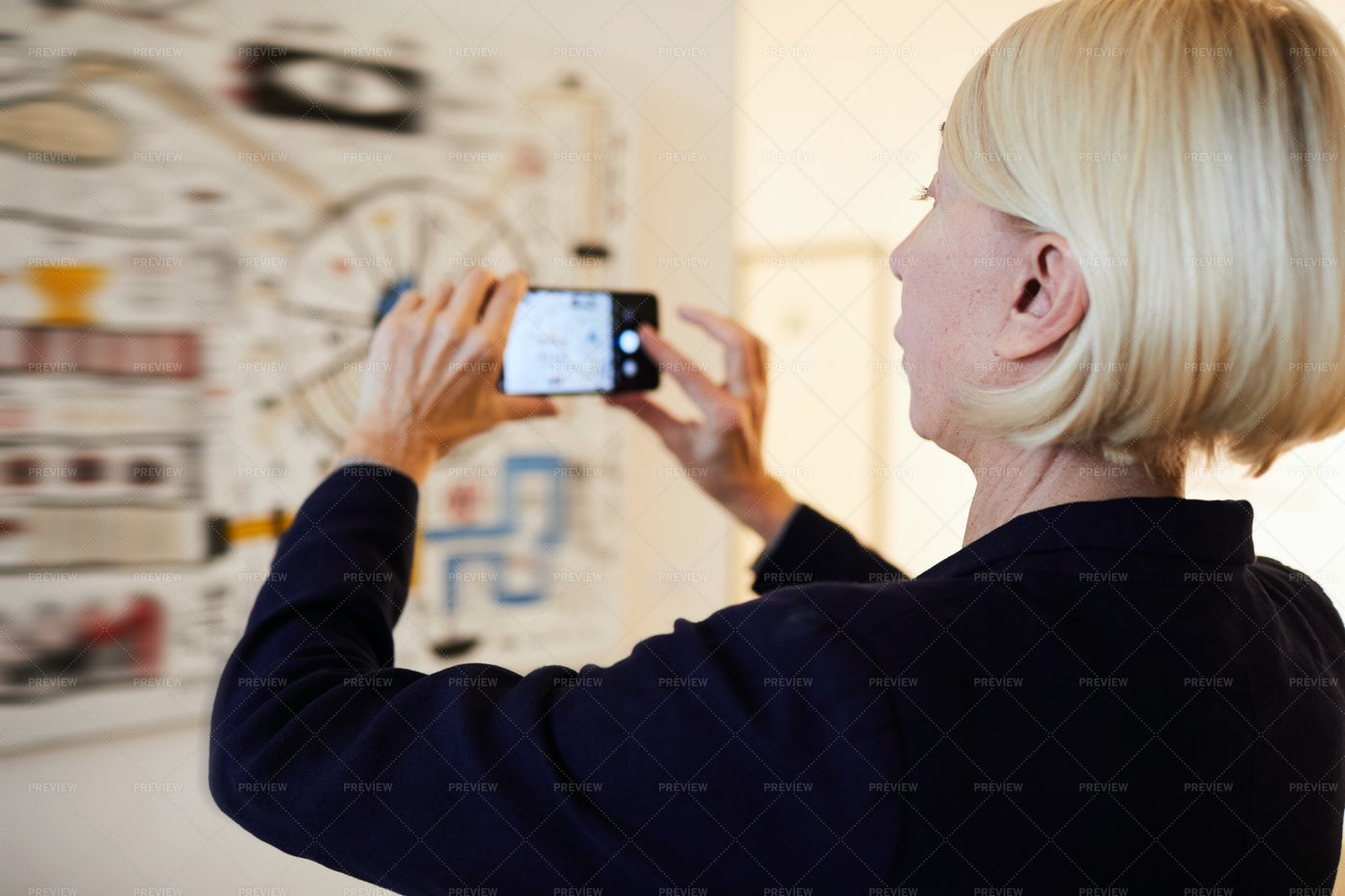 Gallery Visitor Taking Photo Of...: Stock Photos
