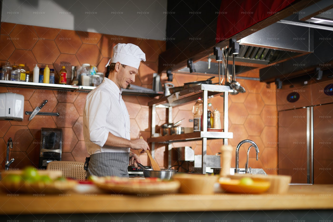Chef Cooking In Restaurant Kitchen: Stock Photos