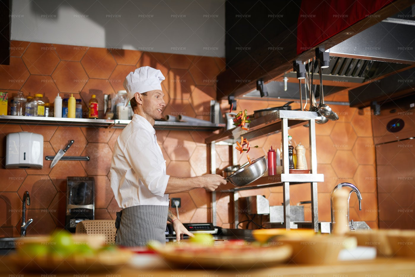 Chef Cooking Vegetables In...: Stock Photos