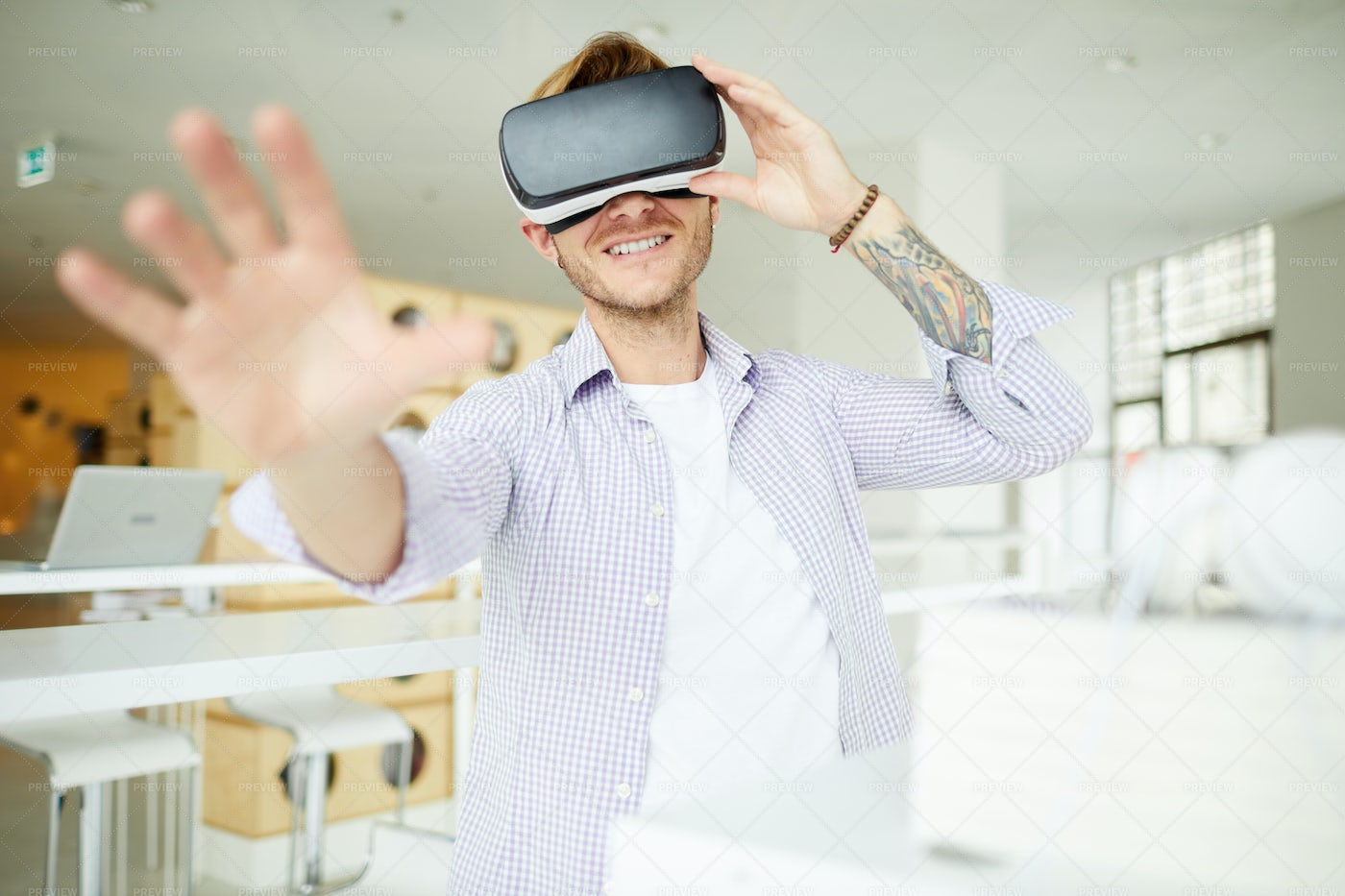 Curious Hipster Guy Immersed Into...: Stock Photos