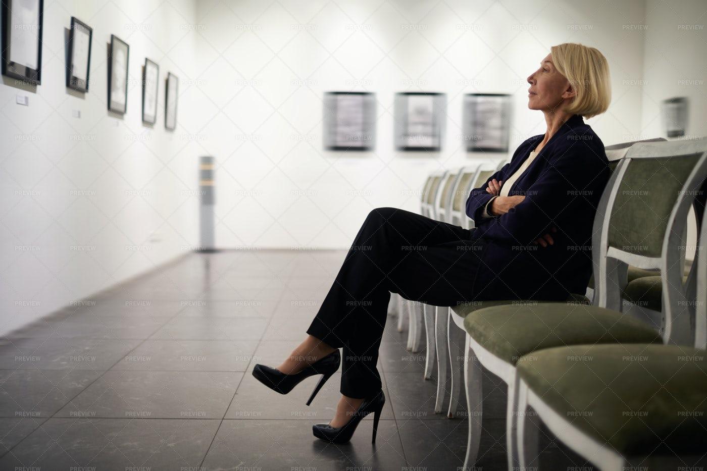Businesswoman In Art Gallery: Stock Photos