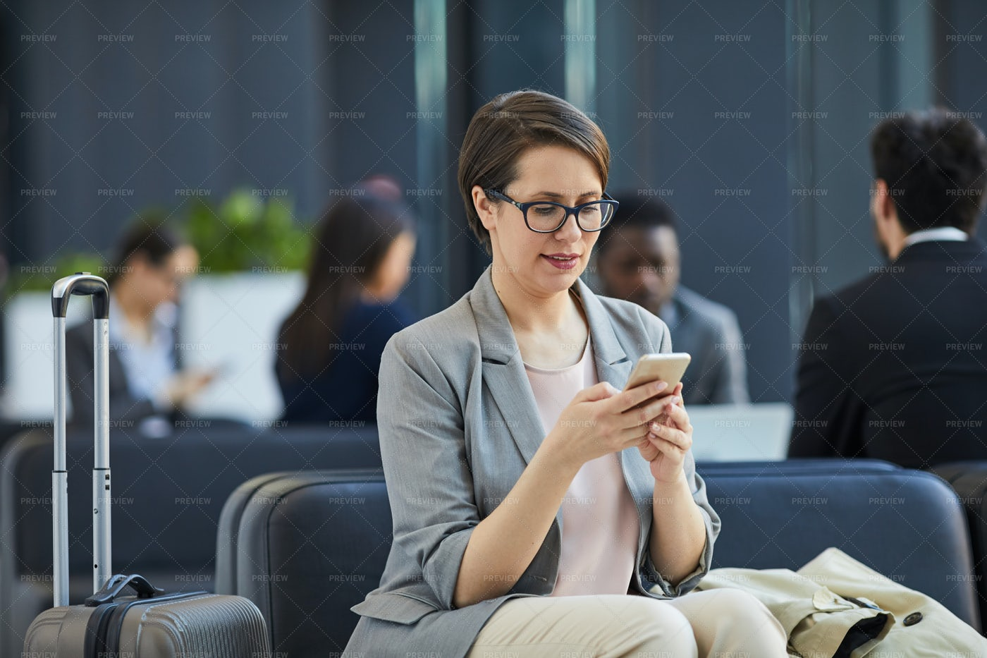 Content Lady Checking Messengers In...: Stock Photos