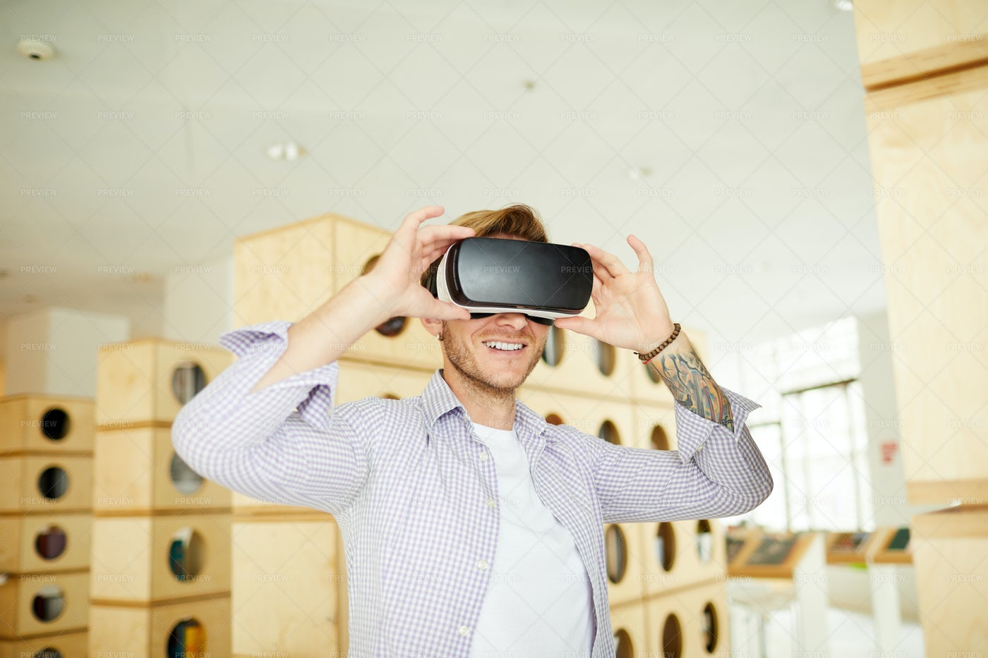Adjusting Virtual Reality Headset: Stock Photos