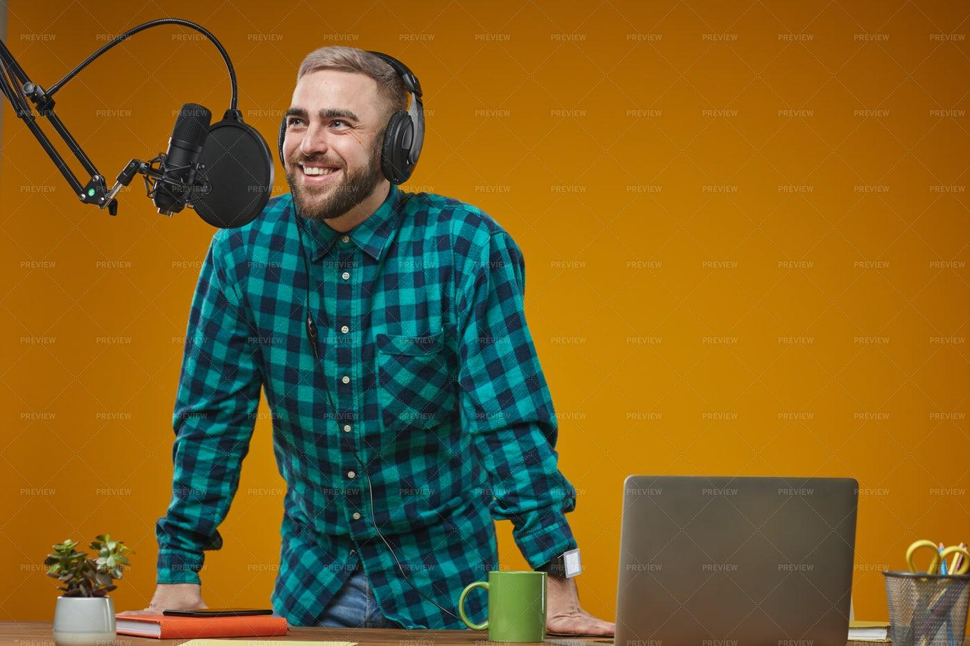 Radio Broadcaster Working In Studio: Stock Photos