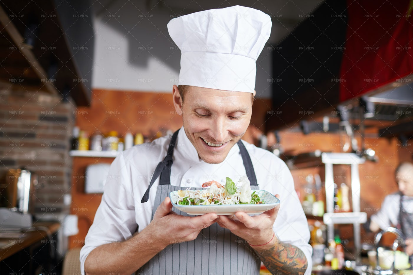 Smiling Chef Presenting Beautiful...: Stock Photos