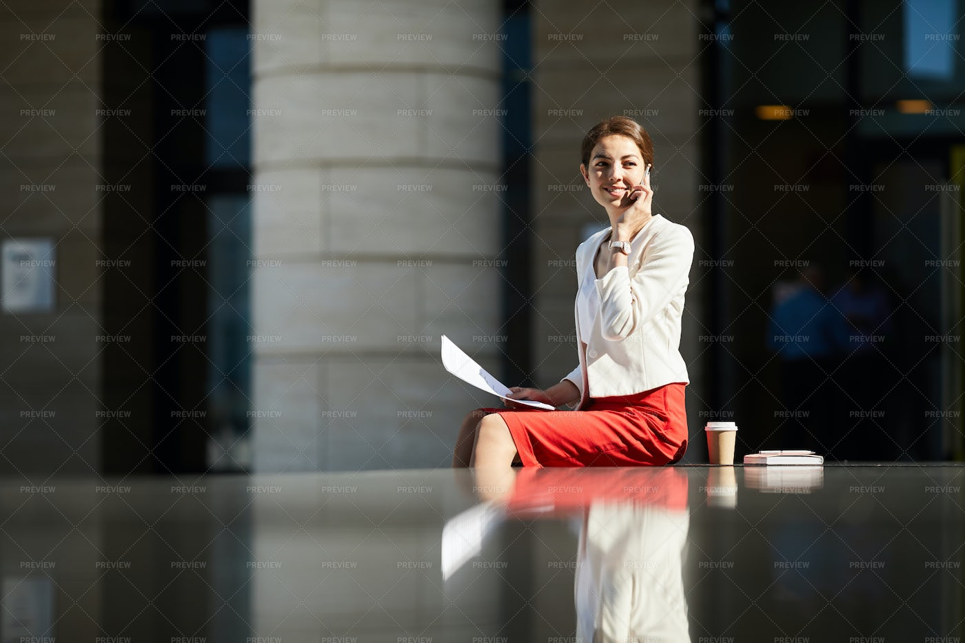Smiling Businesswoman Speaking By...: Stock Photos