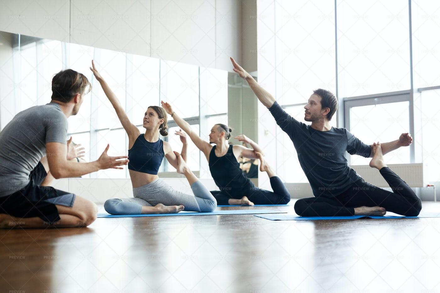 Yoga Coach Explaining How To Do...: Stock Photos