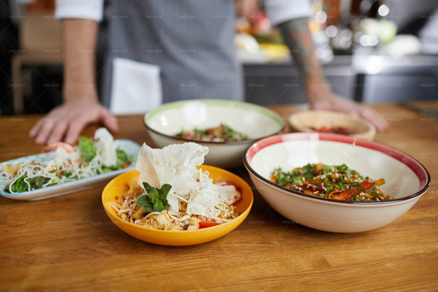 Asian Food On Table In Restaurant: Stock Photos