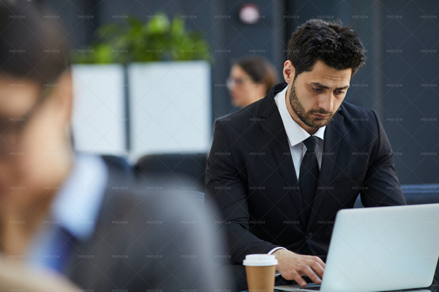Thoughtful Businessman Working In...: Stock Photos