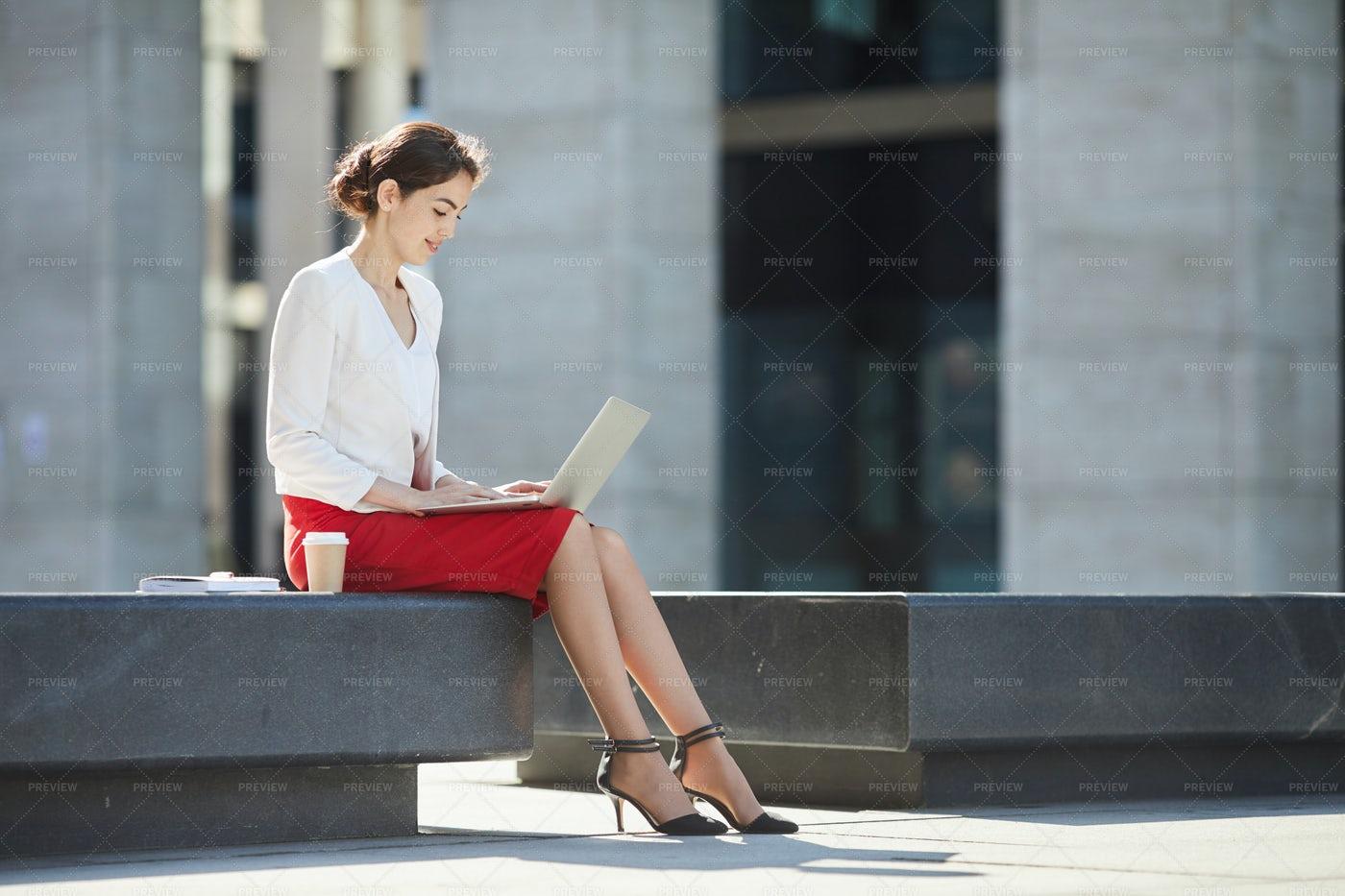 Elegant Businesswoman Using Laptop...: Stock Photos