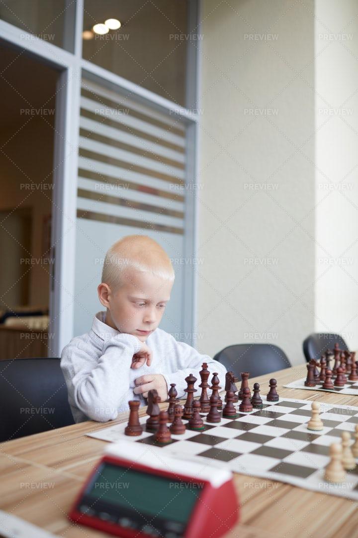 Boy Analyzing Chess Game: Stock Photos