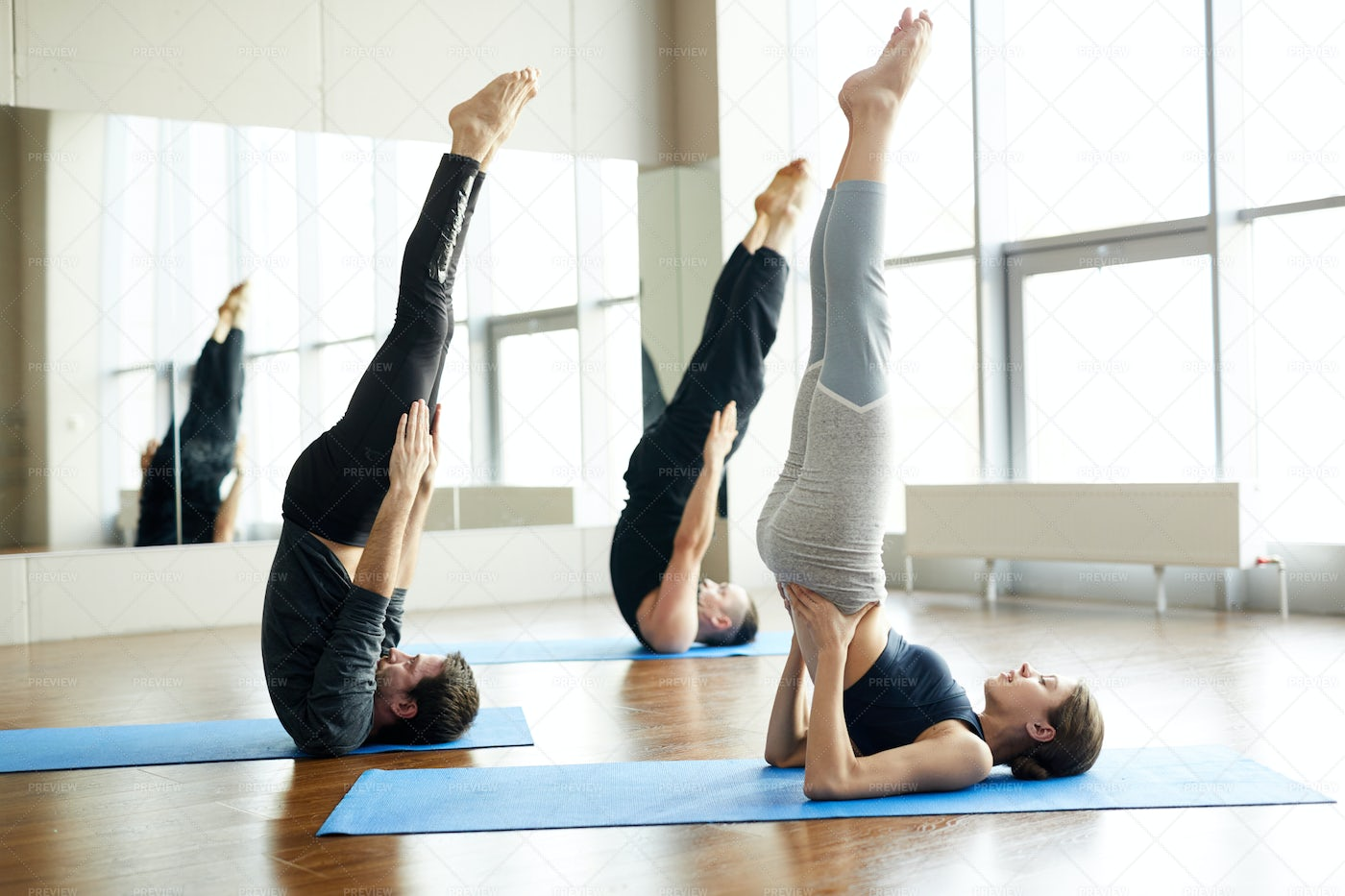 Practicing Candle Pose At Yoga...: Stock Photos