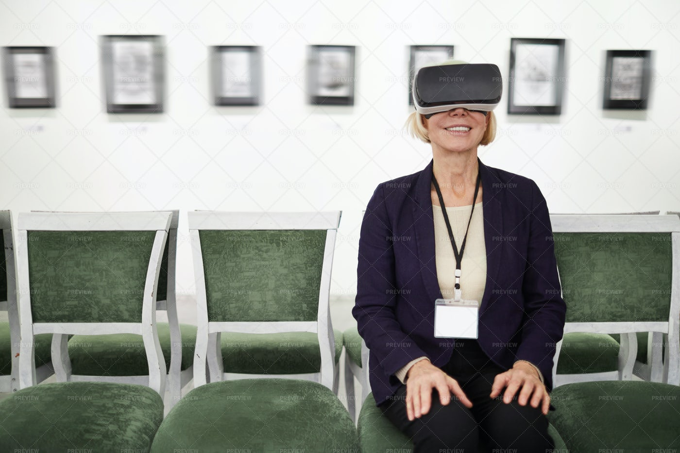 Woman Watching VR In Museum: Stock Photos
