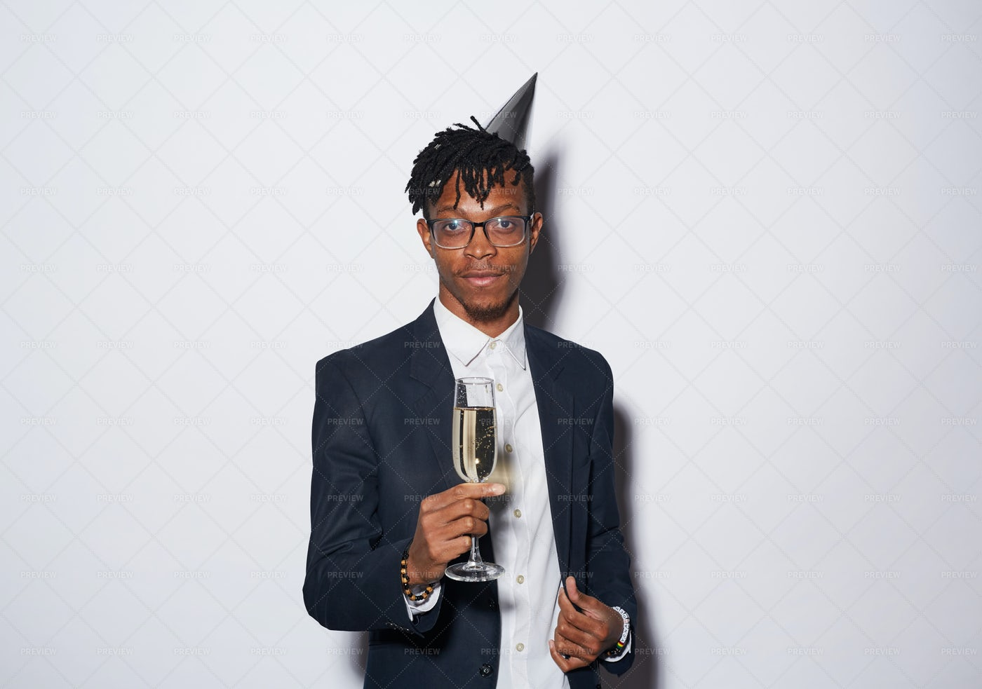 African Man Posing With Champagne...: Stock Photos