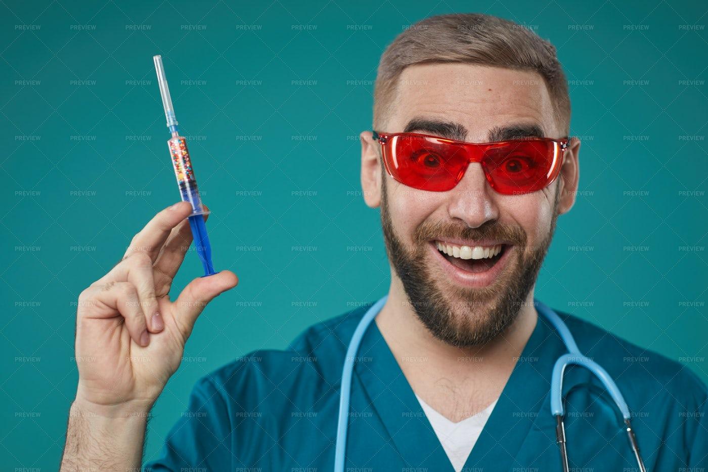 Joyful Doctor With Injector: Stock Photos
