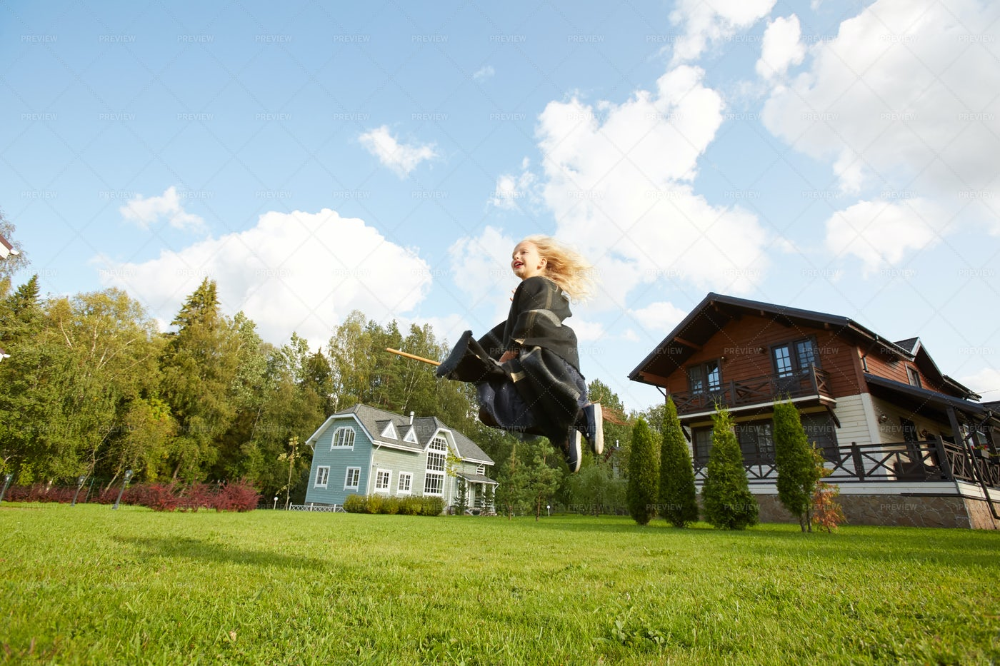 Little Witch Flying On Broomstick: Stock Photos