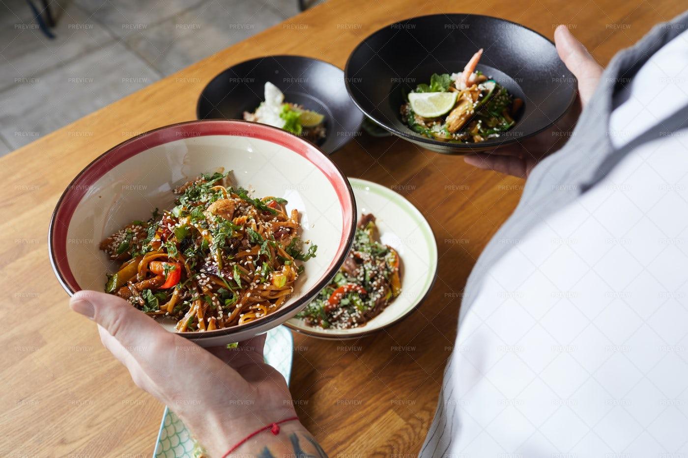 Waiter Holding Delicious Oriental...: Stock Photos