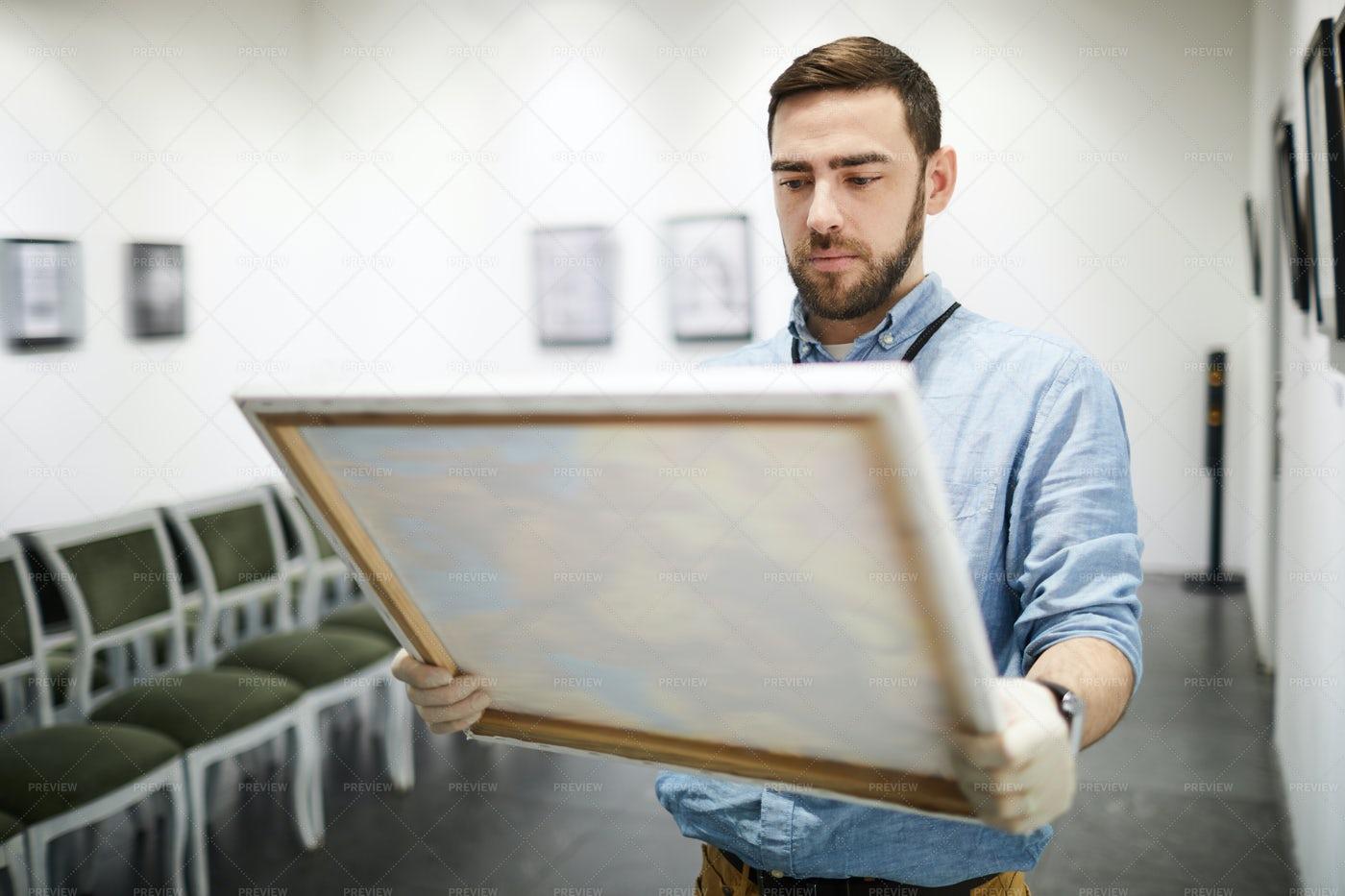 Man Buying Painting: Stock Photos