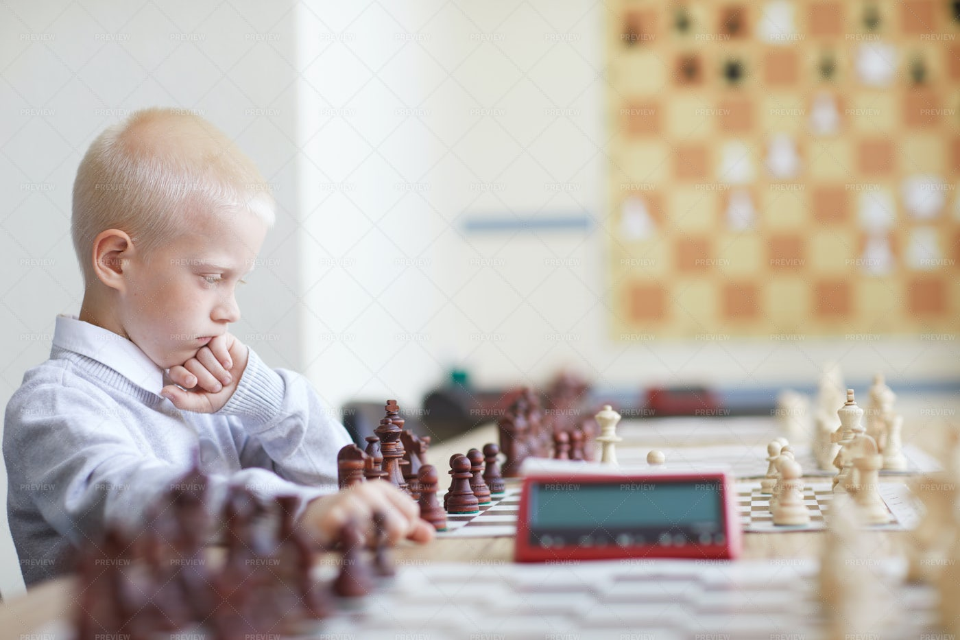 Serious Schoolboy Playing Chess: Stock Photos