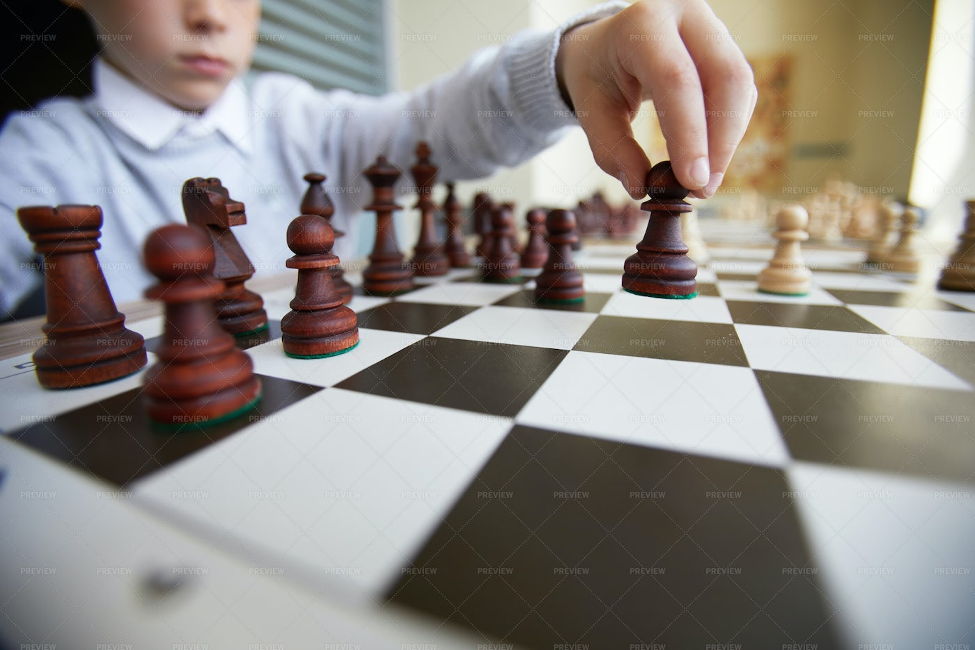 Boy Making Chess Move: Stock Photos