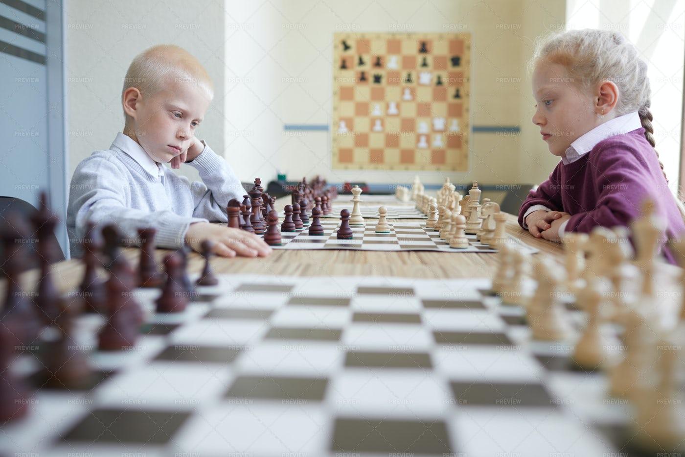 Schoolchildren Playing Chess: Stock Photos