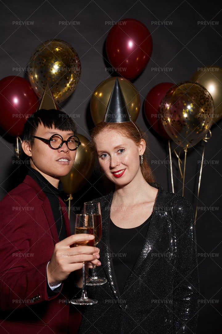 Mixed-Race Couple Posing At Party: Stock Photos