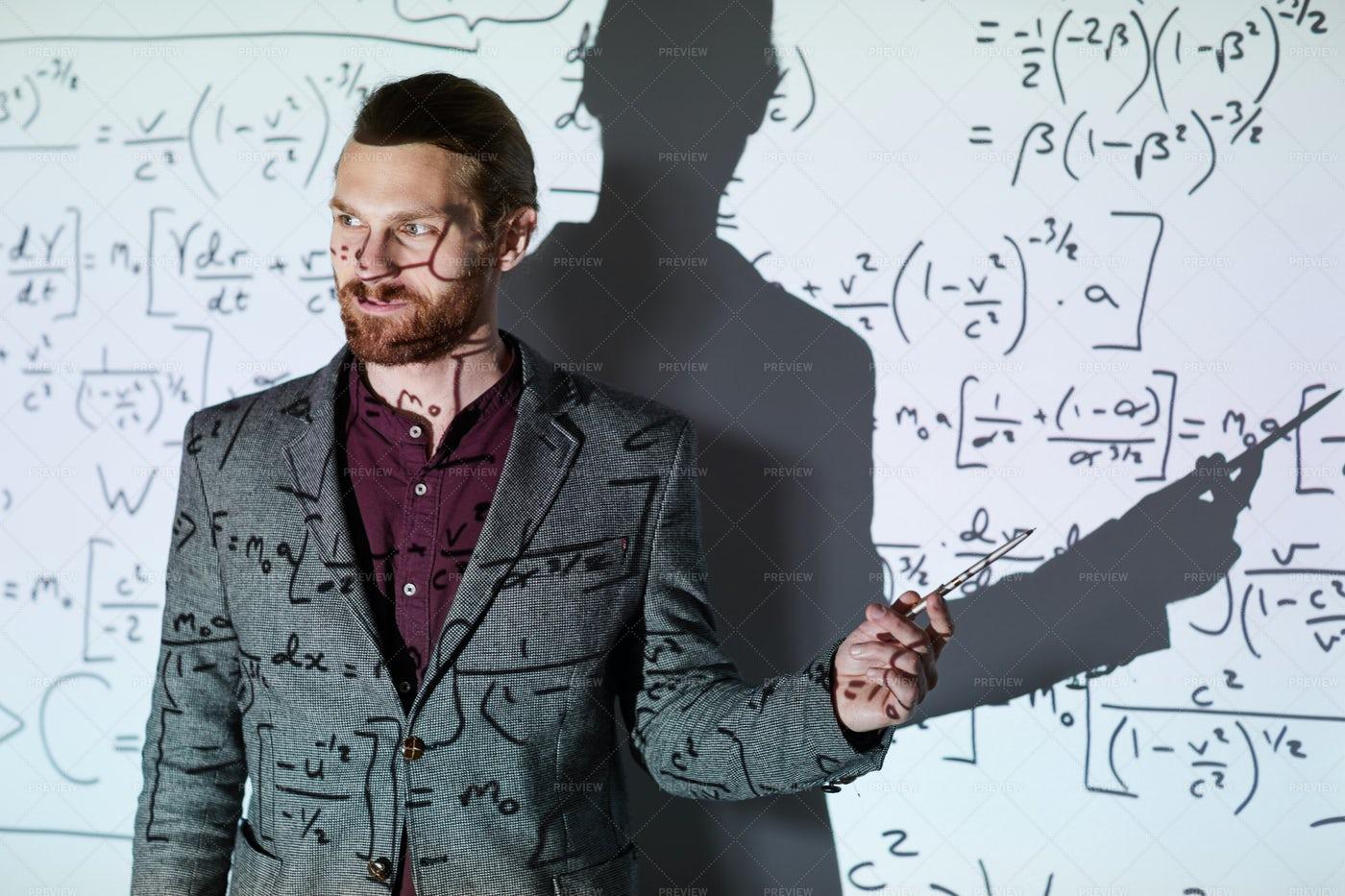Math Teacher Explaining...: Stock Photos